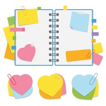 Um bloco de notas aberto colorido na primavera com folhas em branco e marcadores entre as páginas.