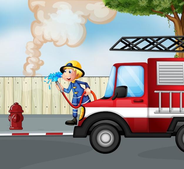 Um bombeiro resgatando um incêndio perto da rua