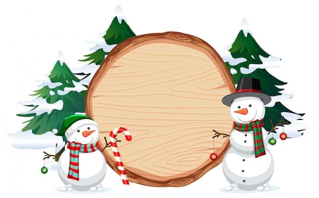 Um boneco de neve na bandeira de madeira
