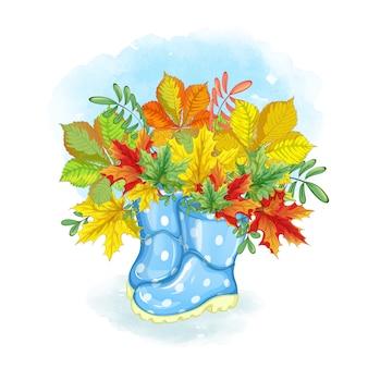 Um buquê de folhas de outono bonitas em botas de borracha azul brilhante.