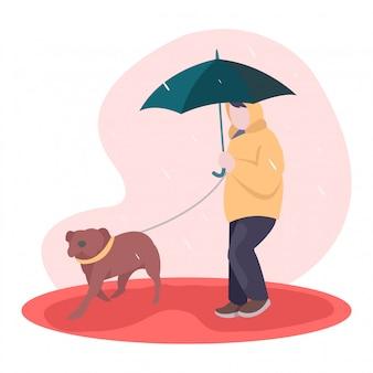 Um cachorro brinca no meio da estação chuvosa com seu dono