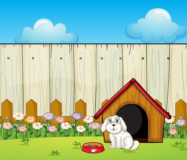 Um cachorro e a casa de cachorro dentro da cerca