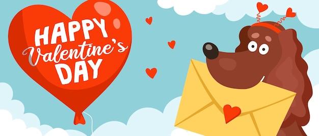 Um cão spaniel fofo e engraçado segura um envelope com um cartão de dia dos namorados nos dentes e um grande balão vermelho feliz dia dos namorados