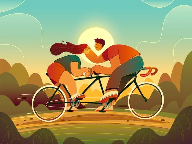 Um cara e uma garota andam de bicicleta tandem