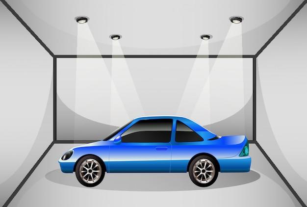 Um carro colorido azul dentro da garagem