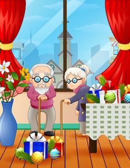 Um casal de avós comemorando o natal na casa