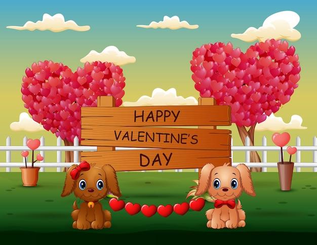 Um casal de cães dos namorados com coração vermelho no sweet park