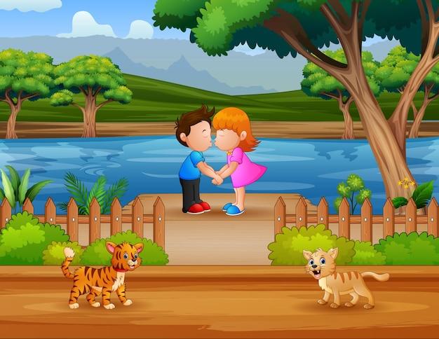 Um casal de crianças se beijando na ilustração do píer