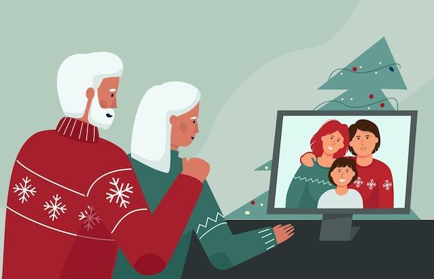 Um casal de idosos se comunica com parentes por meio de uma videoconferência de natal online