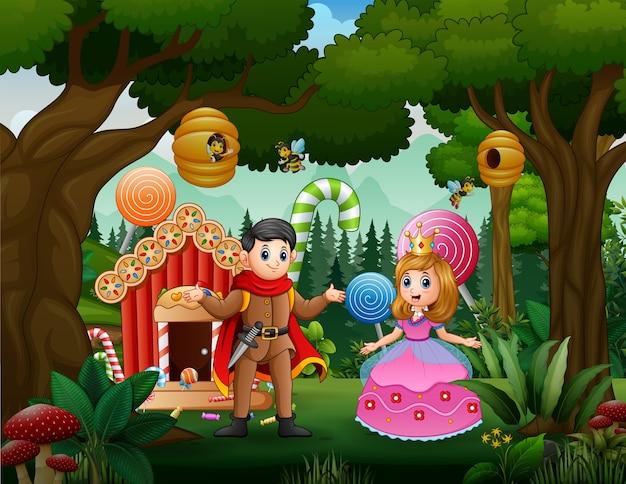 Um casal de príncipe e princesa com uma casa de doces na floresta