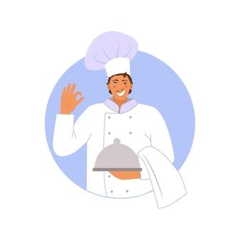 Um chef sorridente de uniforme com uma placa de prata na mão, fazendo um gesto de ok. apartamento. ilustração vetorial.