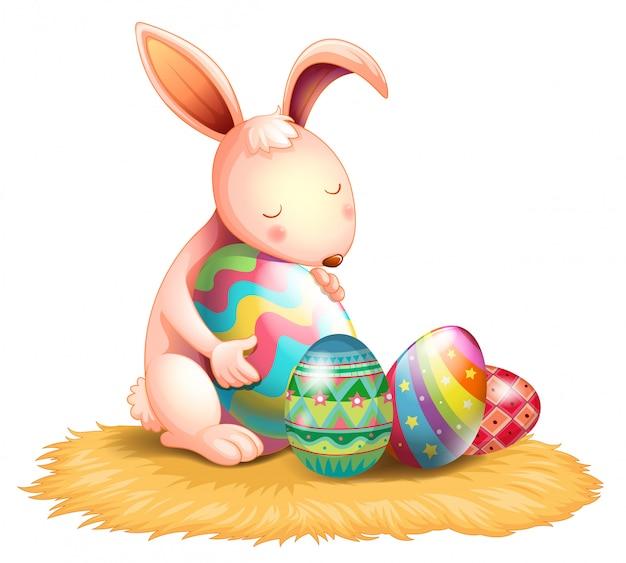 Um coelho abraçando um ovo de páscoa