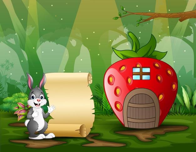 Um coelho adorável com uma placa de papel perto da ilustração da casa da fantasia