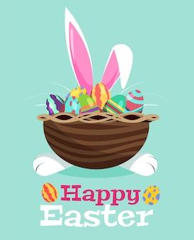 Um coelho branco se esconde atrás de uma cesta com ilustrações de ovos de páscoa