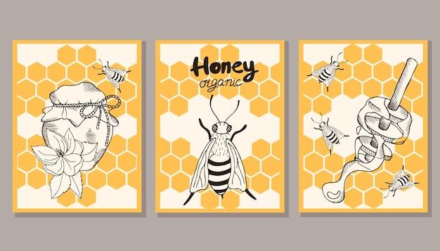 Um conjunto de cartas com favos de mel, uma abelha, um pote de mel, flores.