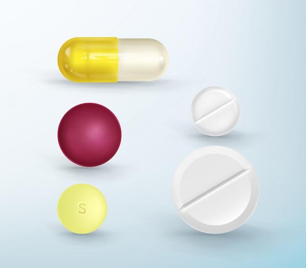 Um conjunto de comprimidos multicoloridos de formas diferentes.