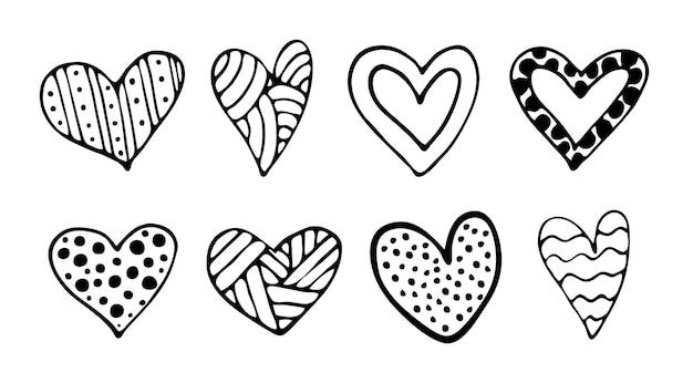 Um conjunto de corações desenhados à mão do doodle do vetor. dia dos namorados, tema de amor