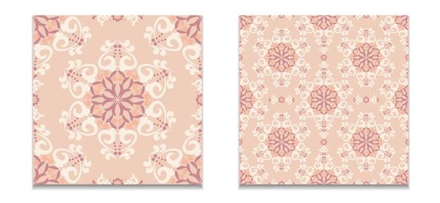 Um conjunto de dois padrões de padrões sem emenda de damasco cor bege-rosa