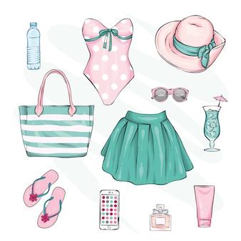 Um conjunto de elegantes roupas e acessórios de verão.