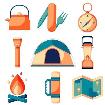 Um conjunto de ícones planos de acampamento e sobrevivência na selva