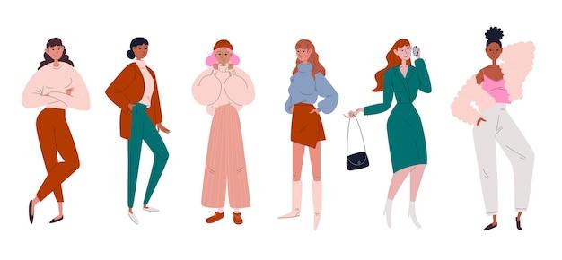 Um conjunto de jovens elegantes se vestiu com roupas da moda e modernas