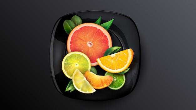 Um conjunto de laranja, toranja, limão e tangerina em um prato escuro.