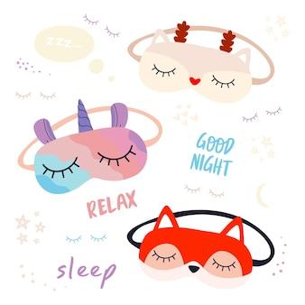 Um conjunto de máscaras de sono com a imagem de um unicórnio, um cervo natalino e uma raposa e as frases.
