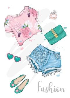 Um conjunto de roupas femininas elegantes, sapatos, cosméticos e acessórios.