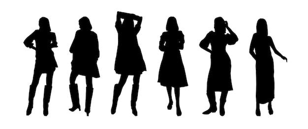 Um conjunto de silhuetas negras de meninas de modelos em vestidos para impressão em camisetas, canecas, bolsas, decoração e design. ilustração vetorial.