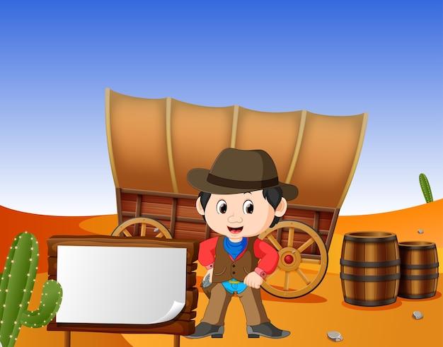 Um cowboy com uma placa de madeira no deserto