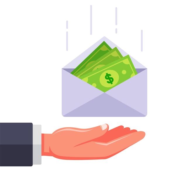 Um envelope com dinheiro cai na mão. ilustração plana