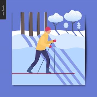 Um esquiador no ensolarado cartão de floresta de inverno coberto de neve