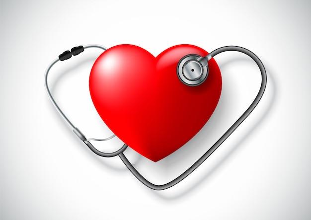 Um estetoscópio em forma de coração e coração vermelho