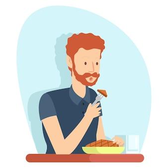 Um funcionário da empresa comendo carne na hora do almoço trazido de casa