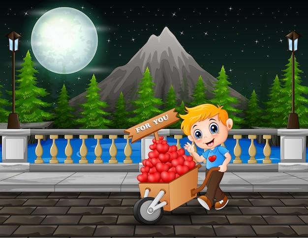 Um fundo de montanha com um menino empurrando o carrinho