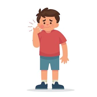 Um garotinho com uma dor de dente