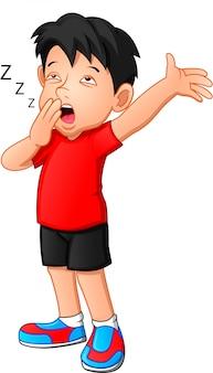 Um garoto cansado e entediado, segurando a mão sobre a boca e bocejando