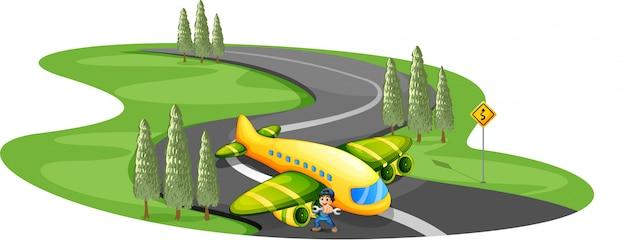 Um garoto com um avião pousando na longa estrada sinuosa