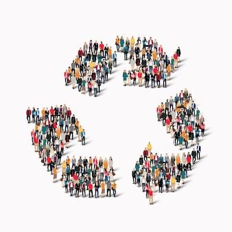 Um grande grupo de pessoas em forma de reciclagem.