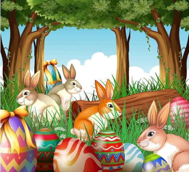 Um grupo de coelhos e ovos de páscoa