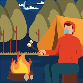 Um homem assando marshmallow sozinho em seu acampamento