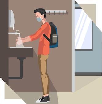Um homem com máscara médica está lavando a mão no banheiro público