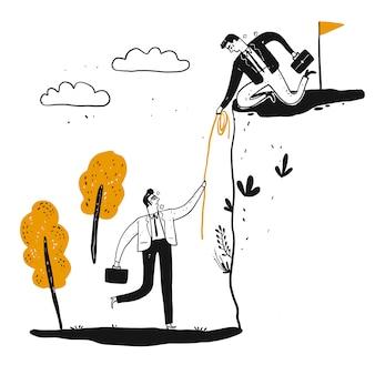 Um homem de negócios masculino está ajudando um homem a subir um penhasco íngreme com uma corda longa