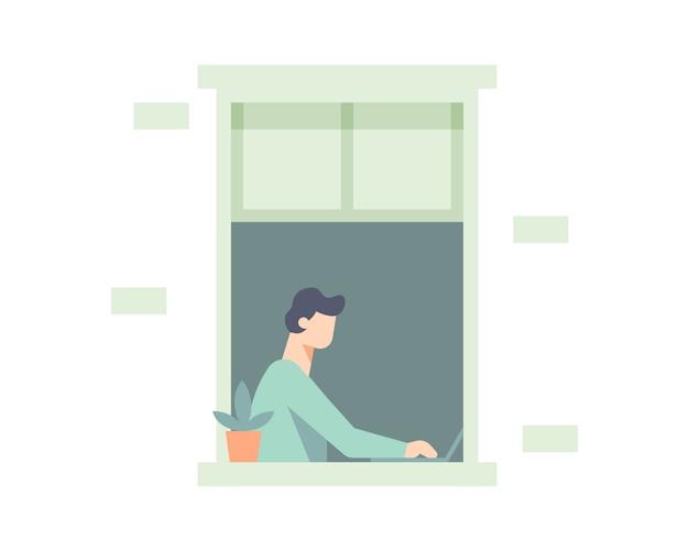 Um homem é visto de uma janela trabalhando em casa em seu laptop