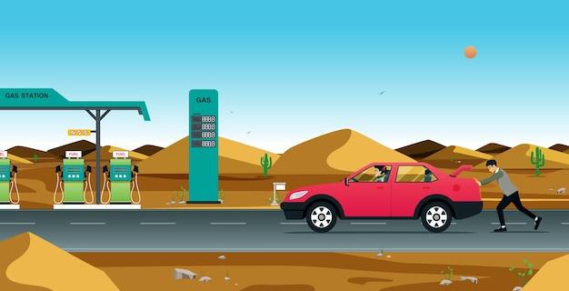 Um homem empurrando um carro parado para um posto de gasolina.