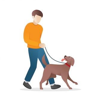 Um homem está andando com seu cachorro