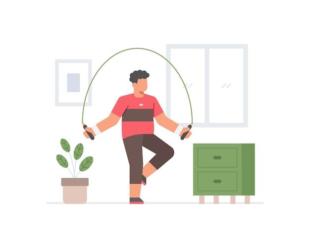 Um homem exercitando em casa fazendo pular corda