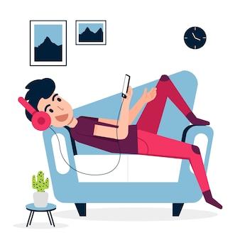Um homem relaxando em casa com música