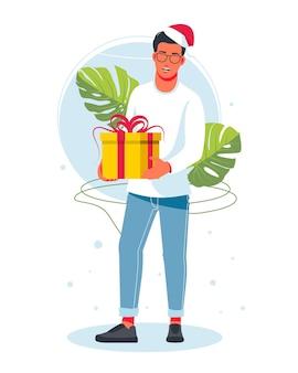 Um homem segurando uma grande caixa com um laço de fita embrulhado em um chapéu de papai noel. conceito de férias, natal e ano novo 2022. pessoas felizes com presentes. ilustração vetorial isolada no fundo branco.
