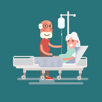Um homem sênior visita um paciente deitado na cama do hospital